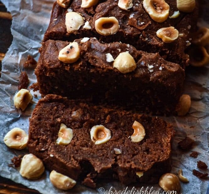 chocolate cake with hazelnuts on a white butter paper
